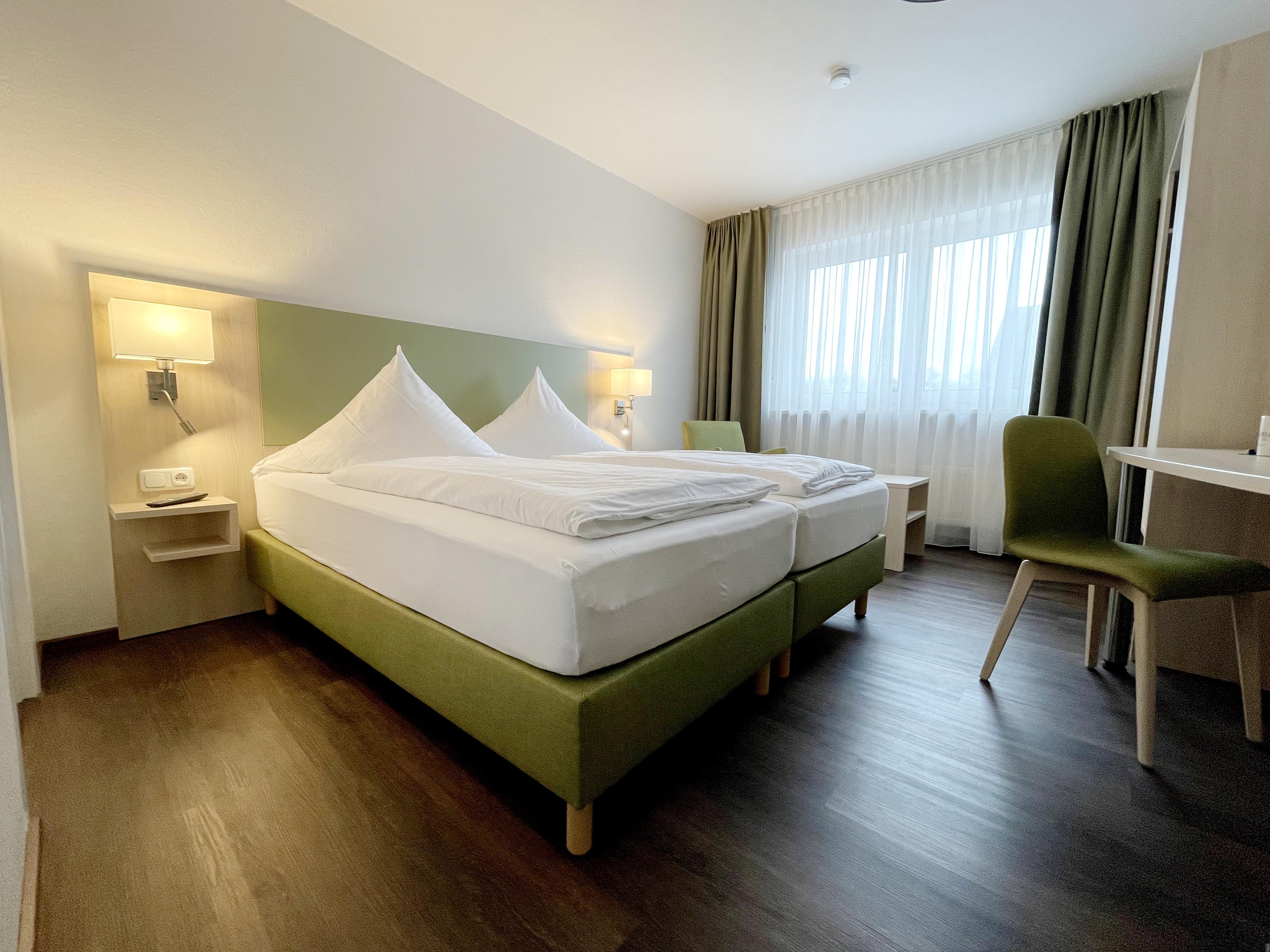 Helle und geräumige Zimmer im Hotel Nähe Flughafen München